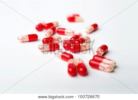 Spilled Red Medicine Capsules, Pills On The White Surface