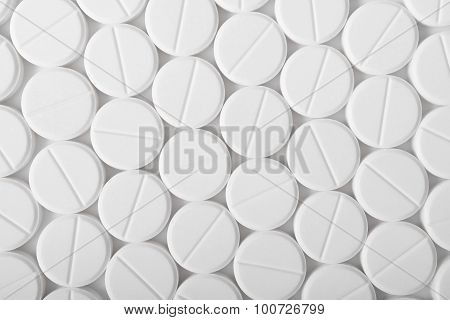 Heap Of Medicine Pills. Background Made From White Pills.