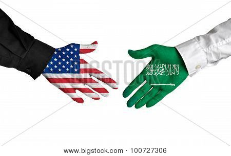 United States and Saudi Arabia leaders shaking hands on a deal agreement