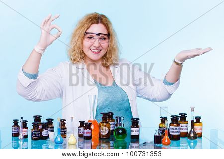 Female Chemistry Student With Test Flask Open Palm