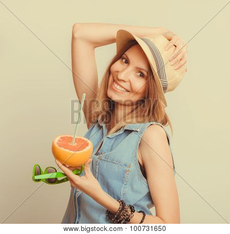 Happy Woman In Hat Drinking Grapefruit Juice. Diet