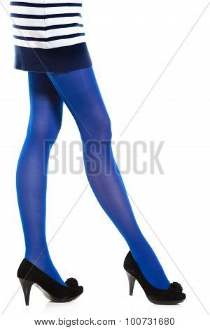 Woman Long Legs And Blue Stockings Isolated