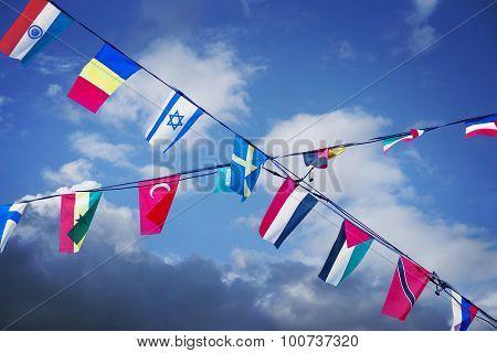 Flags On Blue Sky