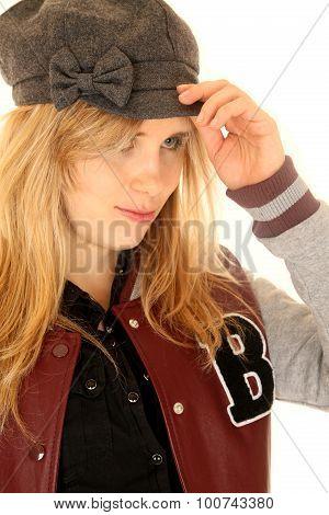 Girl Wearing A Letterman Jacket While Adjusting Her Hat