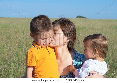 Mother With Son And Daughter In The Summer Field