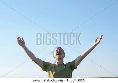 Young Man Screaming With Open Arms