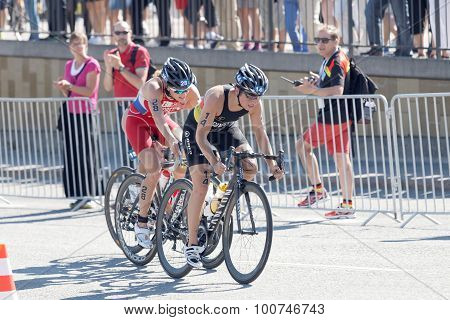 Triathletes Hanna Philippin And Mariya Shorets Cycling A Hill