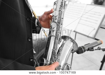 Musician Plays  Saxophone