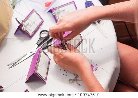 Decorator Makes The Invitation Cards