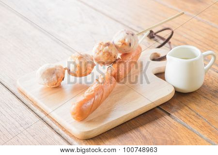 Squid Ball And Hotdog Grilled On Wooden Plate
