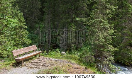 Empty Bench In A Swiss Forrest