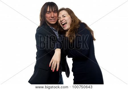 Choking woman in black dress and man