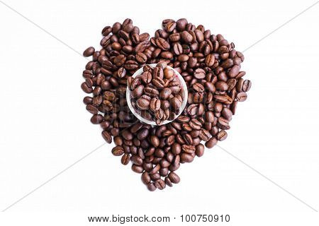 Fresh roasted coffee beans in coffee shot glass