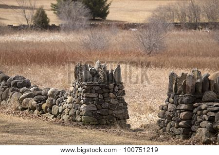 Rock Wall In Grassy Field In Autumn