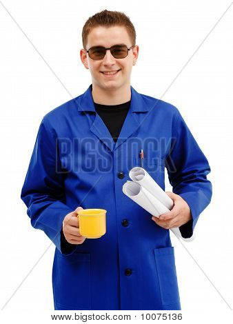 Young technician taking coffee break