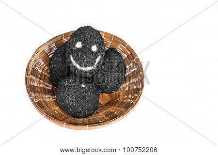 Salted eggs in rattan basket with happy face