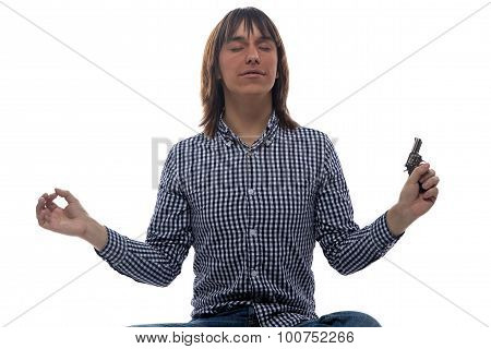 Meditating young man with the gun