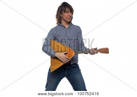 Dancing young man with balalaika