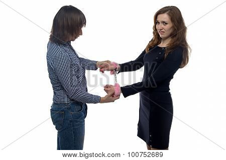 Man and woman with pair of handcuffs