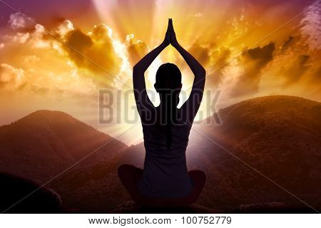 Silhouette Of Asian Woman Doing Yoga