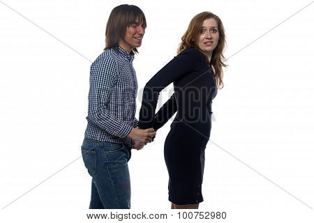 Man and blond woman with pair of handcuffs