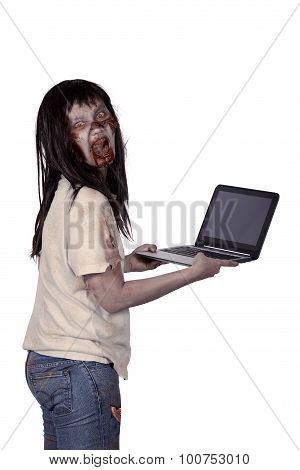 Scary Female Zombie Holding Laptop