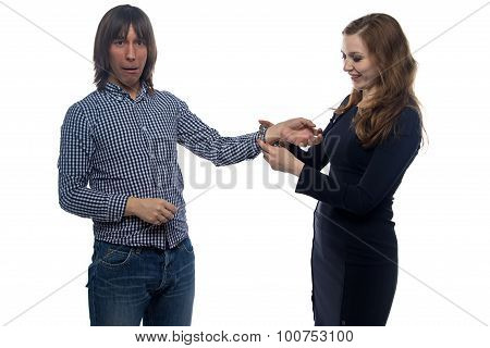 Scared man and woman with handcuffs