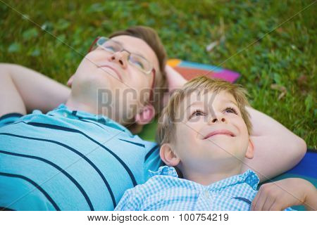 Father With Little Sun At Park