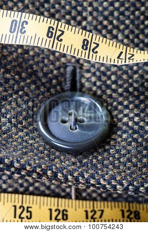 Attaching Of Button To Green Tweed Jacket