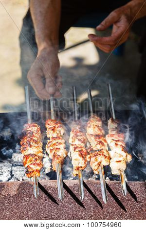 Man Cooks Shish Kebabs On Brazier