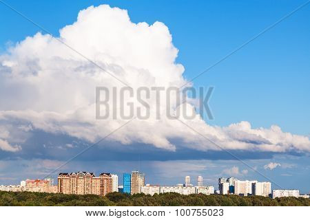 Large Low White Cloud In Blue Sky Over City
