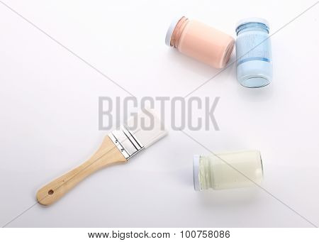 Brush And Bottle Glass Of Color For Painting Art