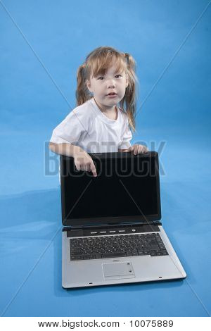 The Little Girl Is Pointing On Computer Screen