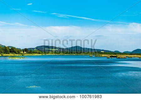 Beautiful green hills and huge lake landscape