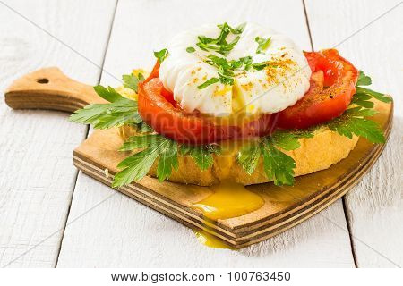 Poached Egg On Toast With Tomatoes And Parsley