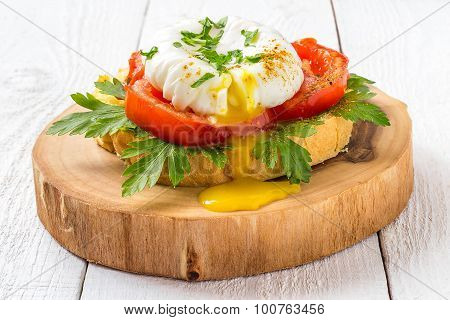 Poached Egg On Toast With Tomatoes And Parsley For Breakfast