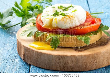 Toast With Poached Egg, Tomatoes And Parsley