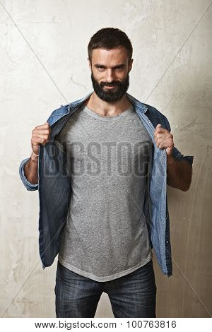 Smiling bearded guy wearing grey t-shirt