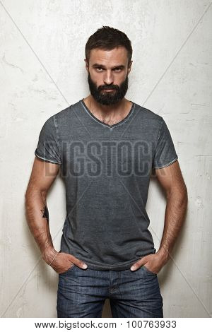 Bearded brutal guy wearing blank grey t-shirt