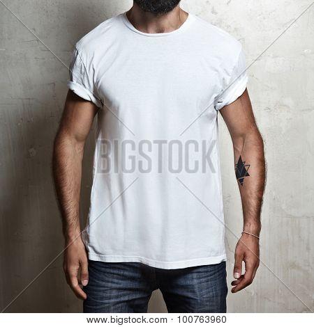 Muscular guy wearing white t-shirt
