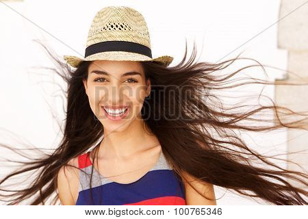 Carefree Young Woman With Long Hair Blowing In The Wind
