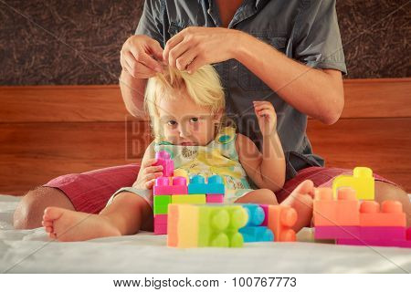 Little Girl Plays Toy Constructor Father Brushes Her Hair