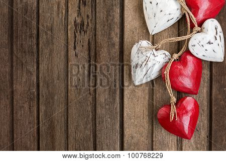 Red And White Wooden Hearts On Old Brown Wooden Background