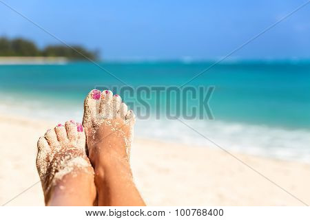 Holiday Concept. Woman Feet Close-up Relaxing On Beach, Enjoying Sun And Splendid View