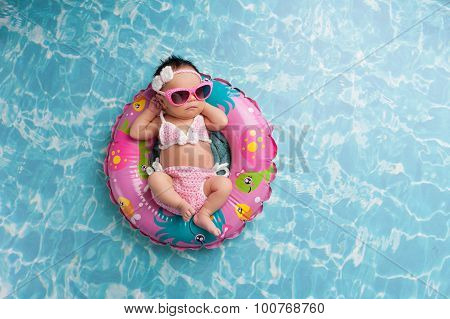 Newborn Baby Girl Wearing A Bikini And Sunglasses