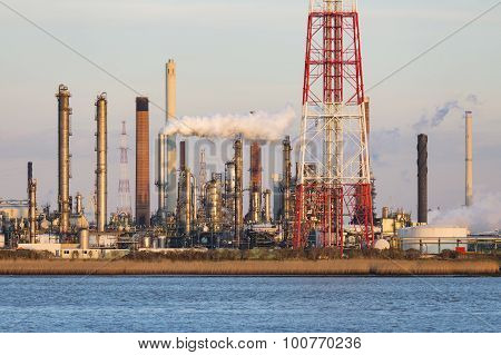 Port Refinery Towers In Evening Sunlight