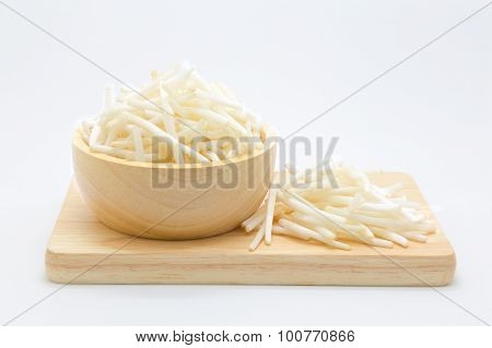 Wooden bowl of bean spouts and wooden board on white background