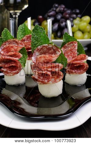 Canape Of Balls With A Melon And Salami