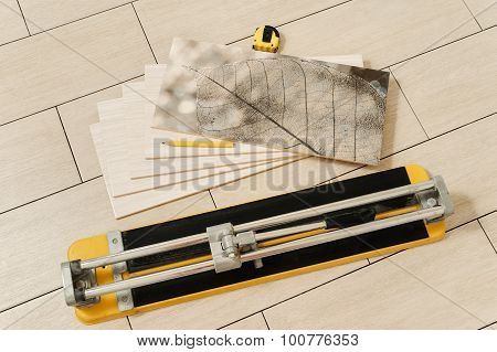 Ceramic Tile, Manual Cutter, Measuring Tape And Pencil