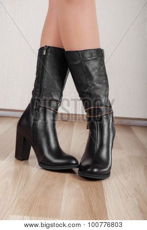 Beautiful patent leather boots with slender legs